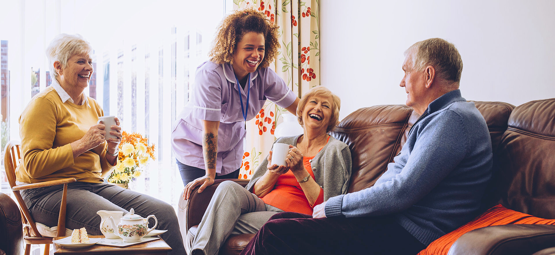 woman with seniors happily chatting