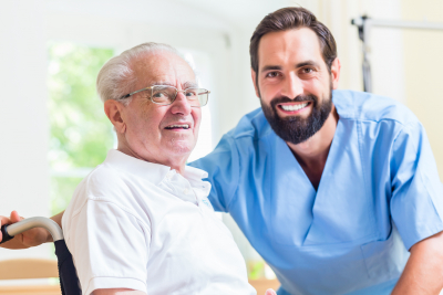 senior man and caregiver in a home care facility